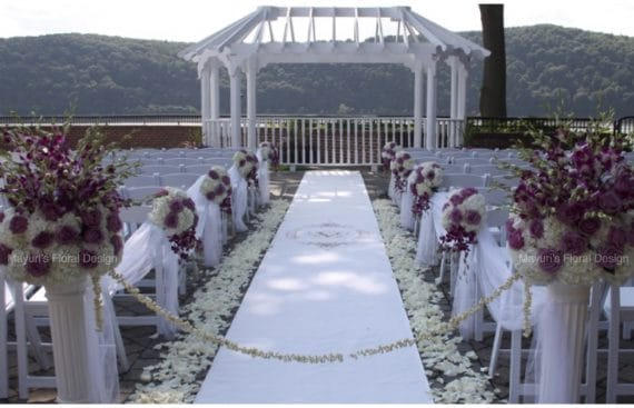 Outdoor Ceremony Hudson River Wedding Florist Orchids hydrangea Petals